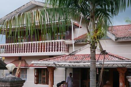 Serene village life outside Mangalore city (3BR)