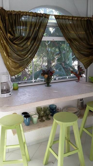 A spacious and large open air windows overlooking the edible gardens from the dining and kitchen area.