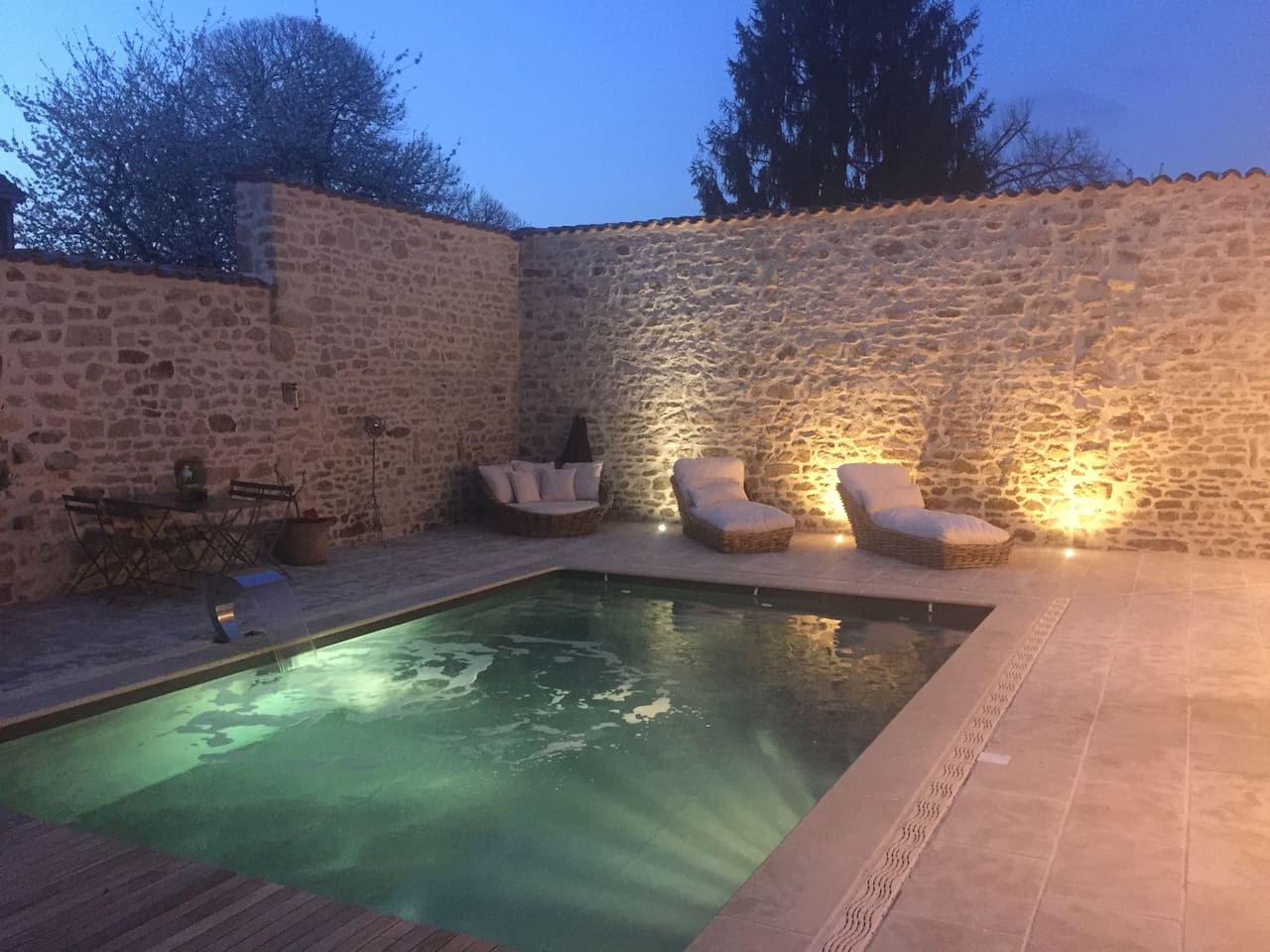 Heated Swimming pool - night time, lights on fountain on.