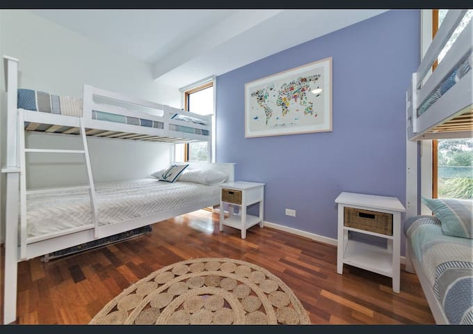 Bedroom 3 downstairs is the perfect kid's quarters and only a few steps from the rumpus room. Sleep 6 of your rowdiest with a single-over-double, a single-over-single, and a rollout. A fold-up cot and other toddler's furniture is also supplied....