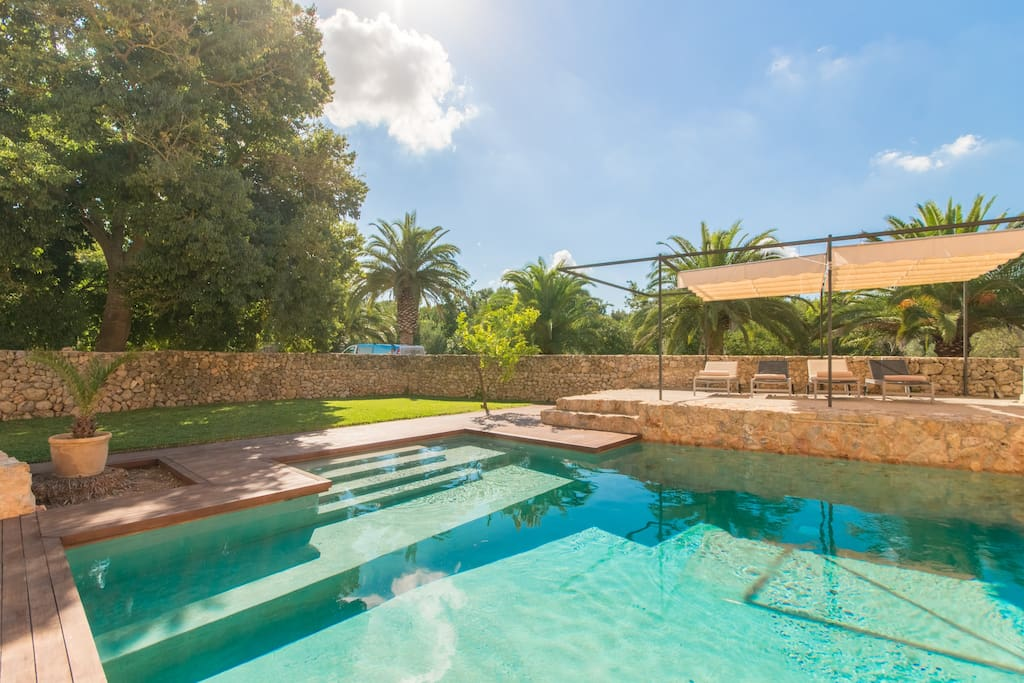 Comfortably walked Pool area, over steps and is encircled with wooden floor.