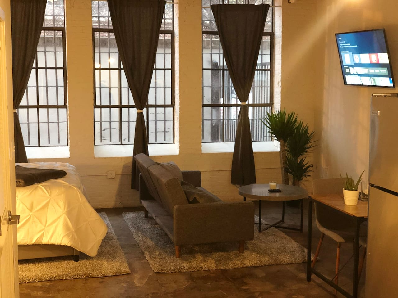 Open loft with high ceilings and beautiful large windows!