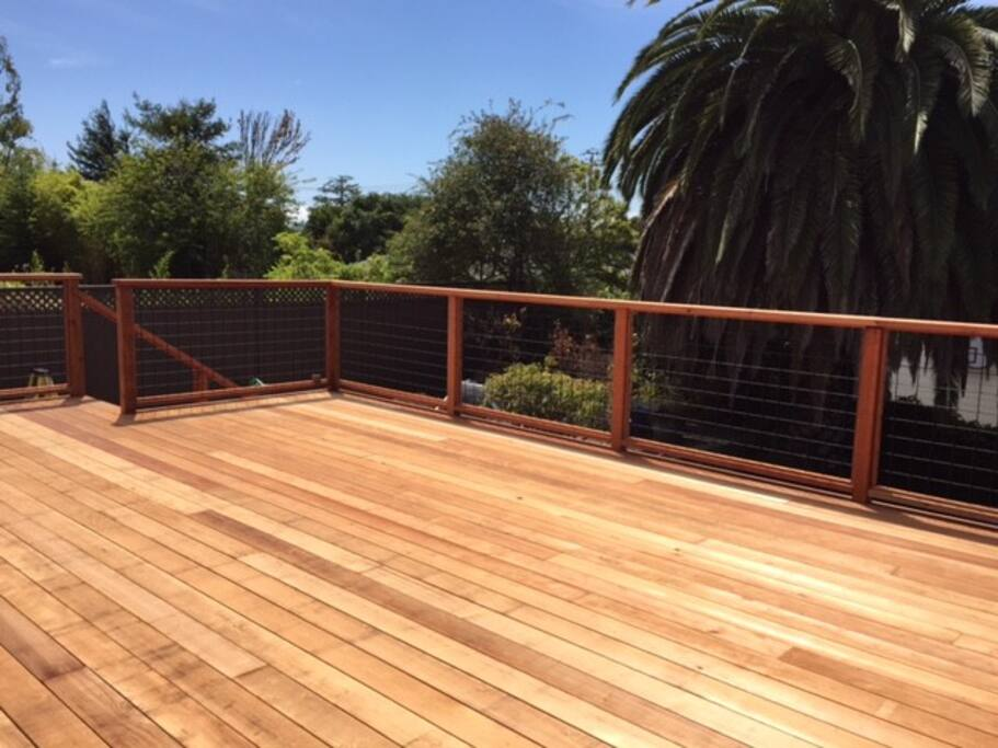 Spacious deck with gardens below and hillside views