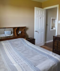 Comfortable private room with smart tv, dresser and closet