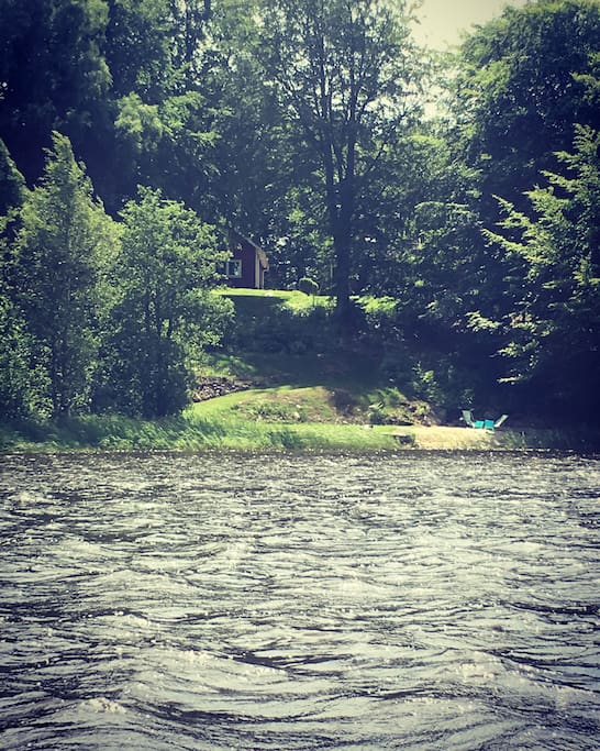 Photo taken from the lake in summer, the house is up on the hill!