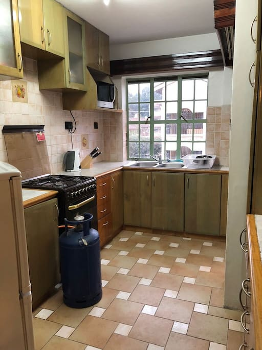 Kitchen with a range of appliances.