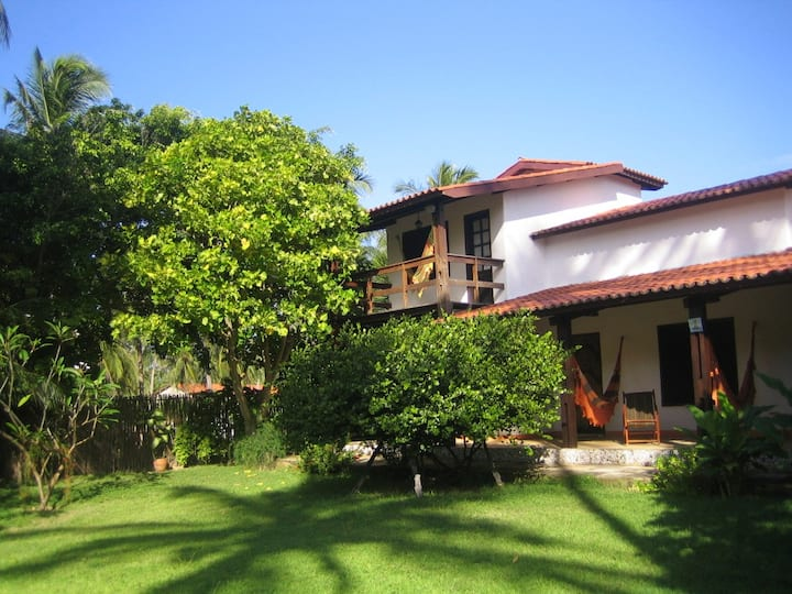 Exotic villa with tropical garden by the beach,