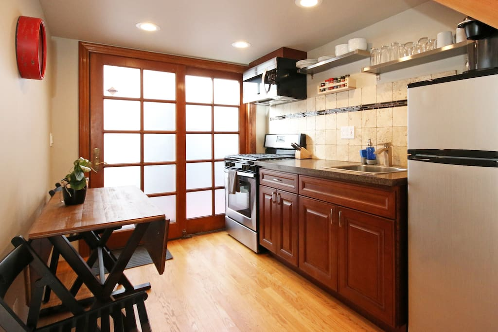 Fully furnished kitchen with gas range.