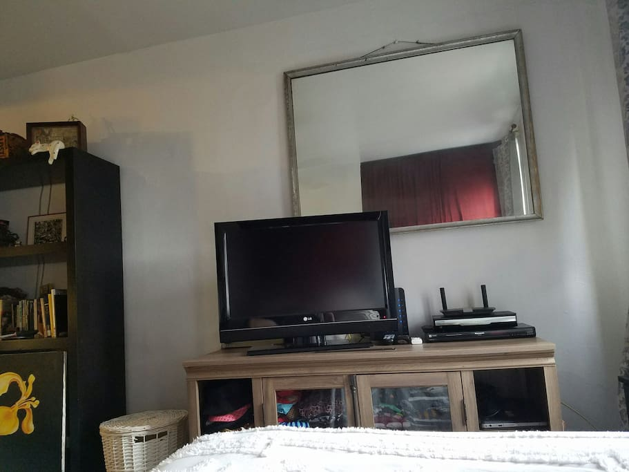 TV with cable at foot of bed
