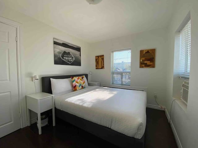 This is the first of 2 Bedrooms on the second floor, which has a Queen bed, a closet to store your things, bedside tables and reading lamps, and lots of natural light.