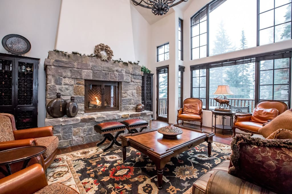 Enjoy your time around the cozy fireplace with views of a beautiful forest