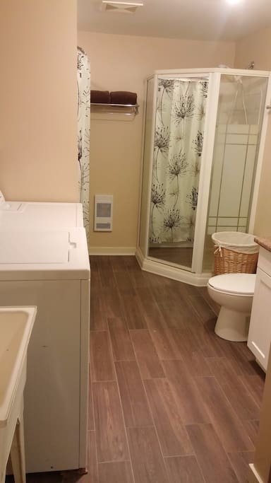 5 piece bathroom including stand up shower, shower/tub combo (with shampoo, conditioner, and body wash in handy pumps), washer and dryer (with complimentary soap and dryer sheets), and utility tub.