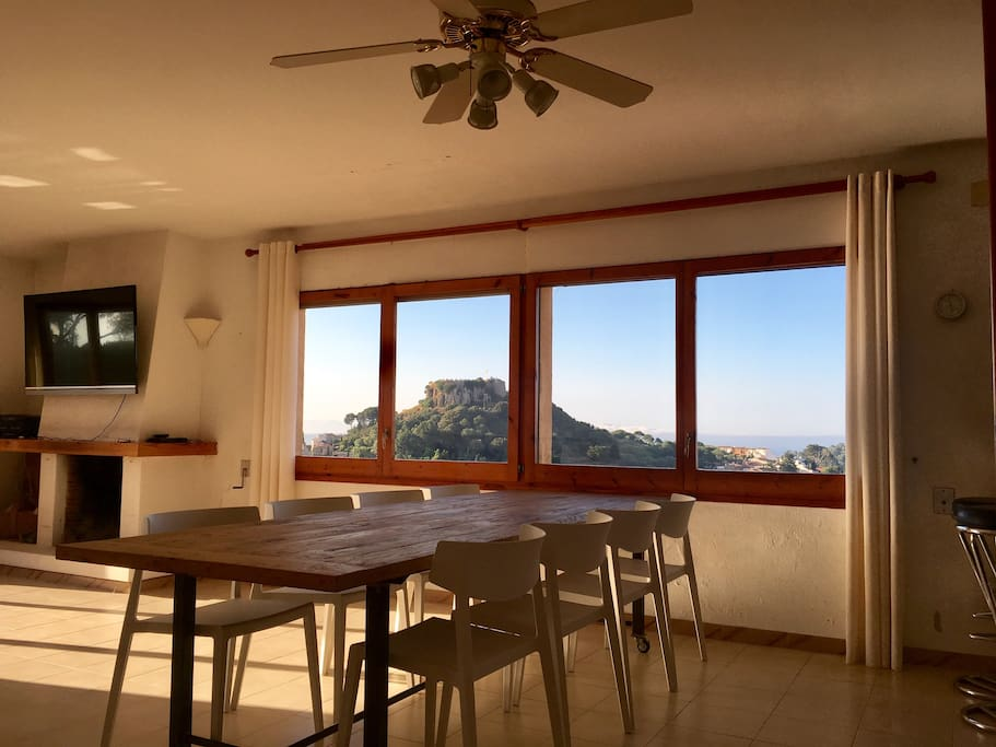 Aged oak dining dining table with 10 chairs - views towards the Begur Castle and Meditarenean sea