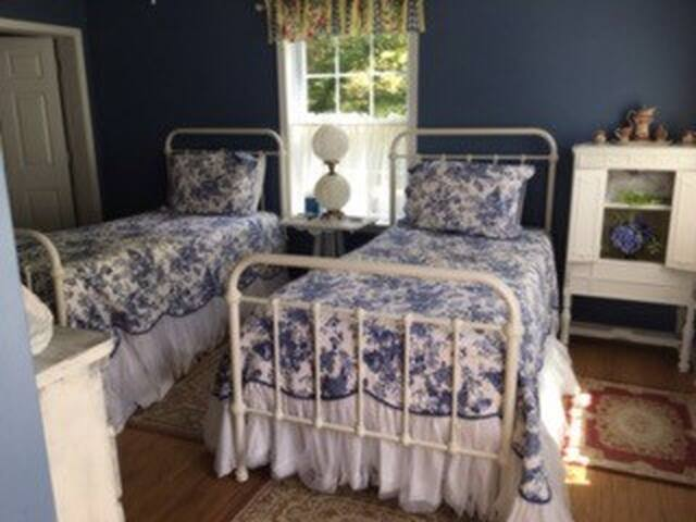 The twin beds are adjustable, lovely for reading in bed.