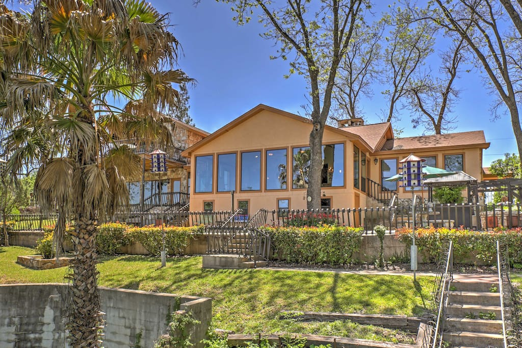 This riverfront 4-bedroom, 3-bathroom vacation rental home in Seguin is the perfect place for families to relax and spend quality time together.