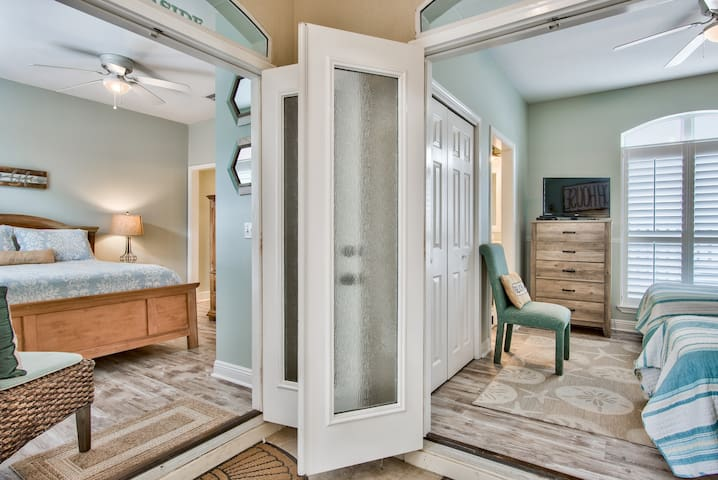 entry into queen bedroom and twin bedroom from shared screened in porch 2020