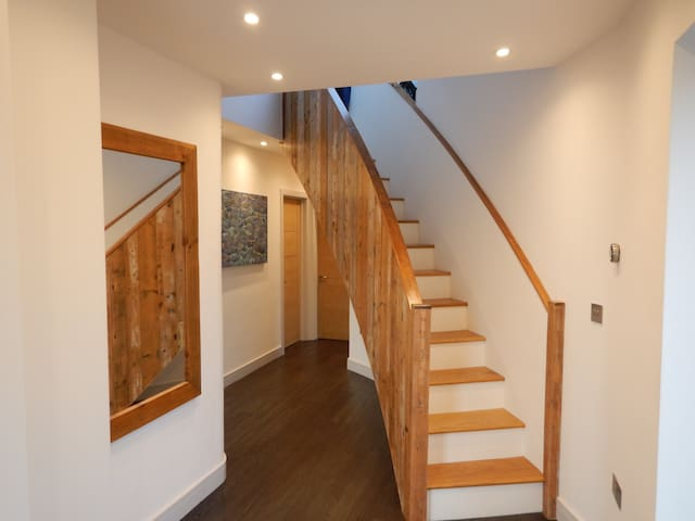 Stairs from entrance hall to Bedroom Suite Two.