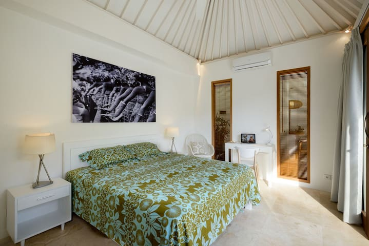 Ground floor bedroom with comfortable king size bed and pool view