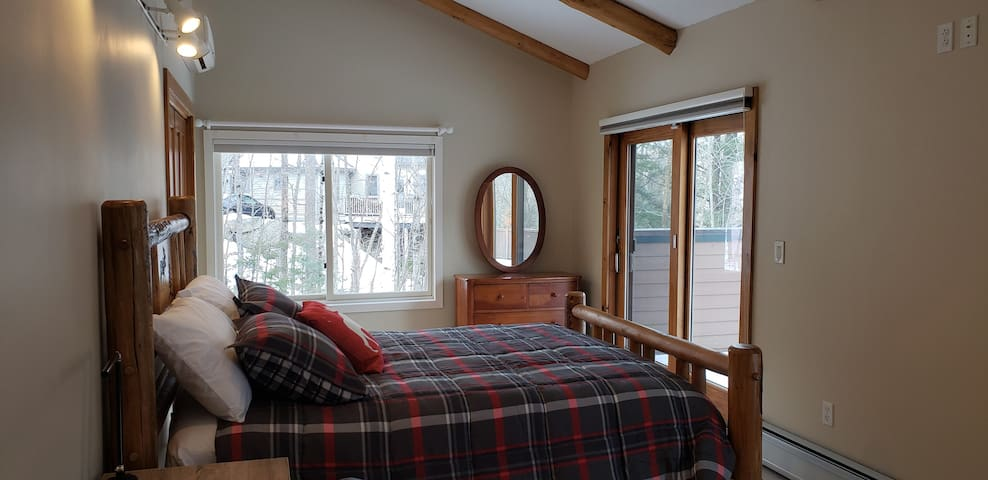 Main level bedroom perfect for a family of 4!  This room has a queen bed and twin bed with twin trundle under.  Enjoy the mountain views from the 2 sliding glass doors and have direct access to the back deck.