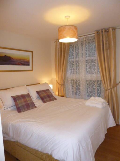 Master bedroom, large, comfortable bed and en-suite shower room off