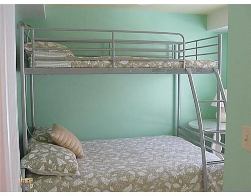 Double bed on the bottom and single bed on top