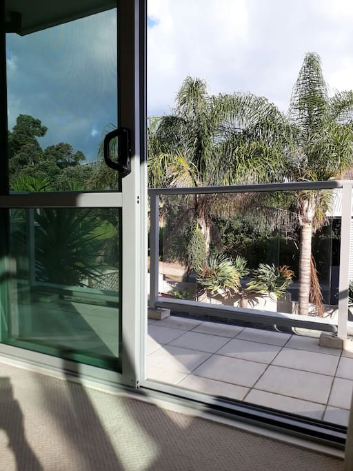 At home by the sea.  Peace, palms and privacy - private deck off bedroom