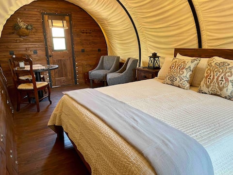 Elegant covered wagon glamping experience
