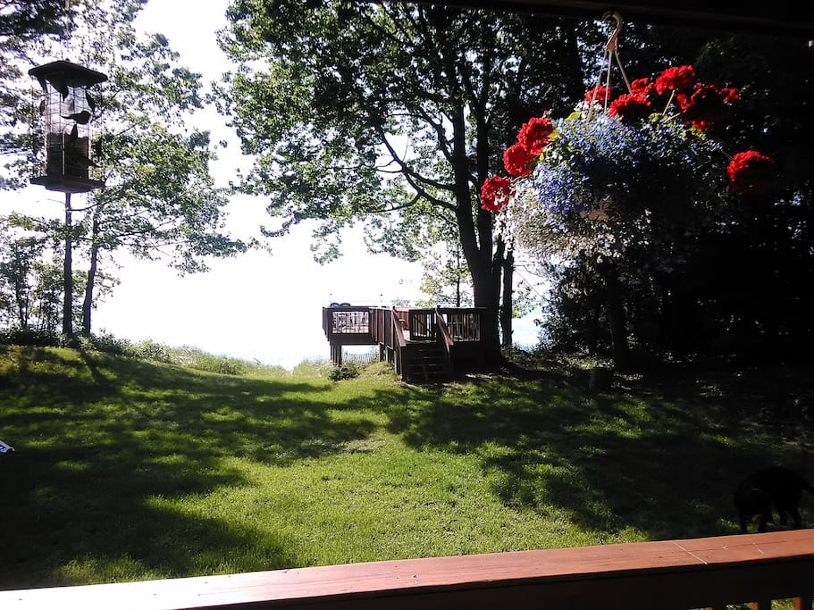 This is the view from the house to the outer Lake MI deck. The deck sits right at the edge of the beach.  Lovely peaceful setting. Awesome views.