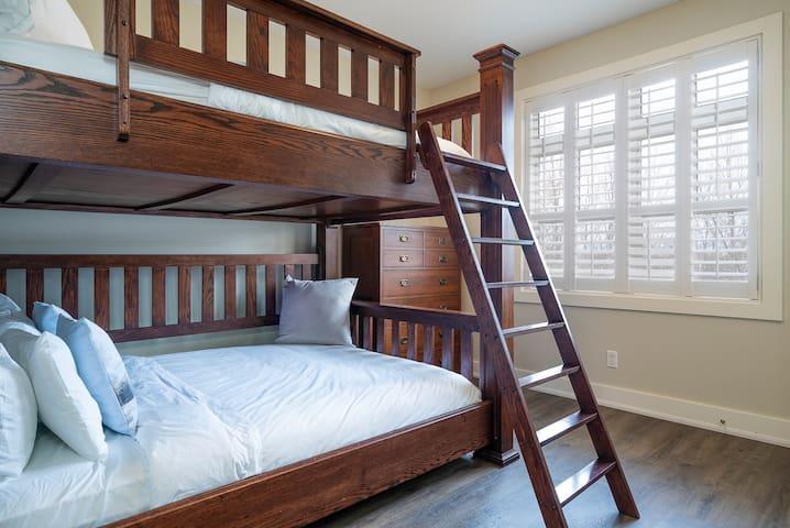 Bedroom located on the Main Floor with a Queen over Queen Bunk Bed