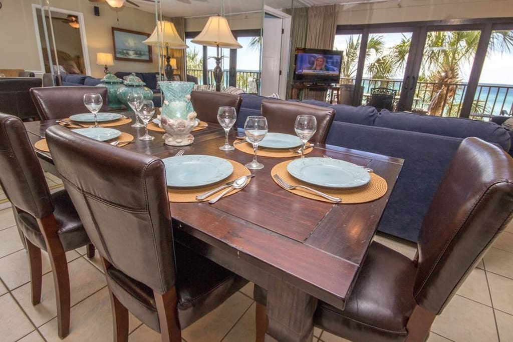 Dining room table with seating for 6 plus 3 stools at the breakfast bar.