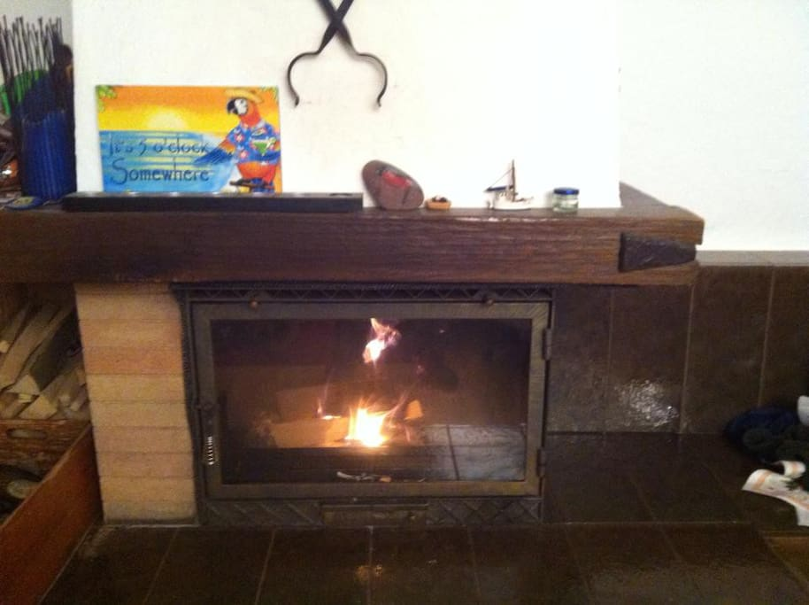 During the colder months this fireplace burns every evening
