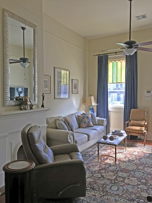 The elegant and comfortable living room – antiques blended with contemporary make this Neoclassical Revival home a refined space to spend your time away.