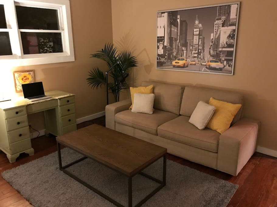 Living room (computer for decorative purposes only, not included in apartment)