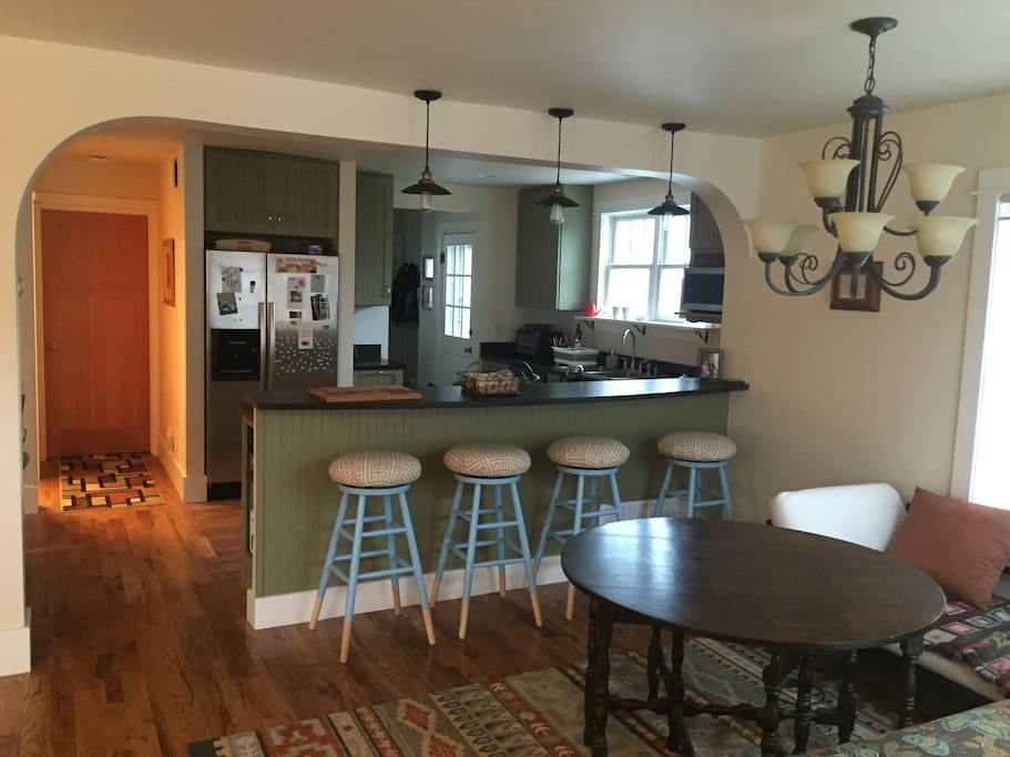 Open kitchen with breakfast bar, fully stocked for cooking meals and entertaining