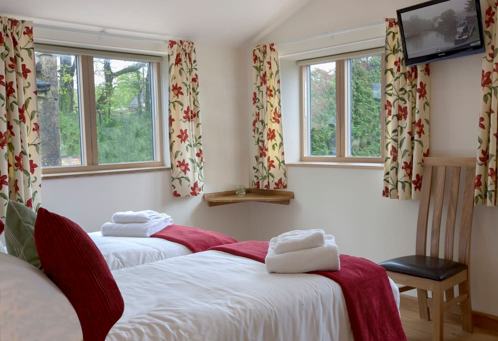 Teal - bedroom can be made up as either twin or super kingsize double, with en-suite shower room, TV and blackout blinds