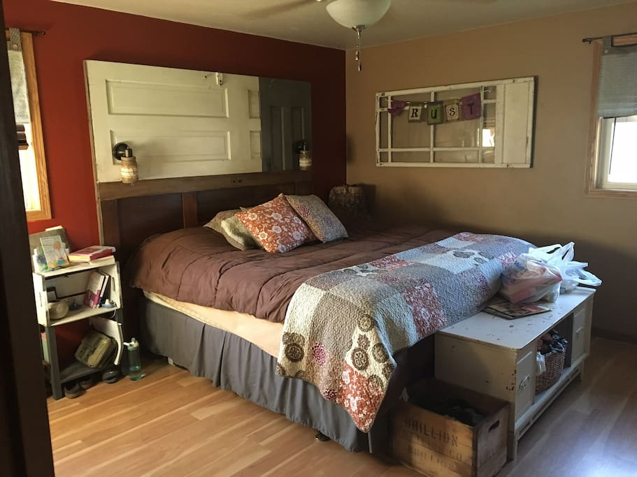 master bedroom with king-size bed and access to the main bathroom