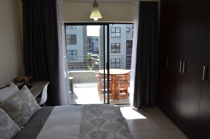 MAIN BED WITH WALKOUT BALCONY