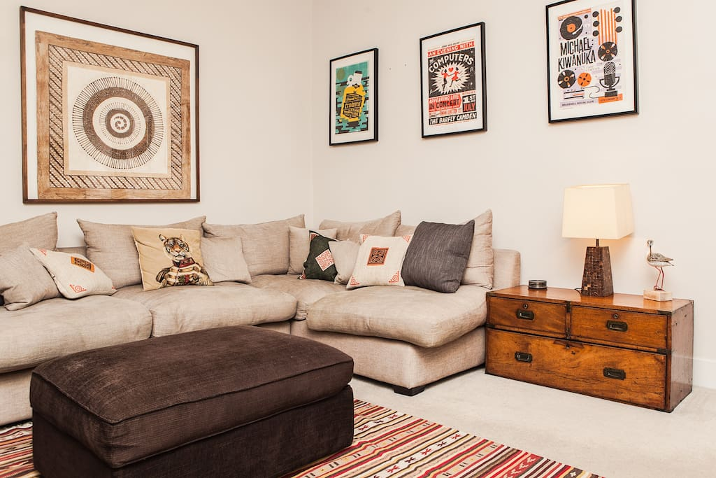 Sitting room with big, comfy sofa.