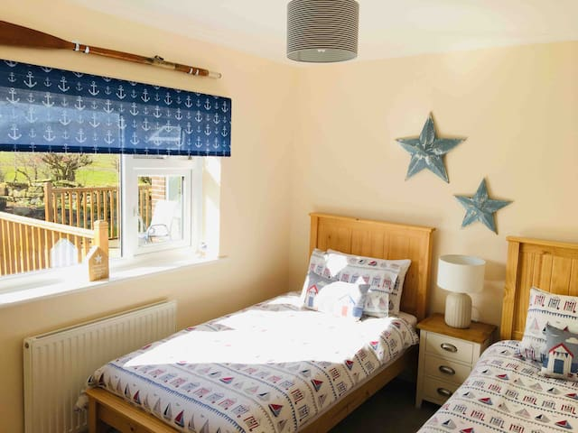 Twin seaside themed bedroom overlooking the private rear garden
