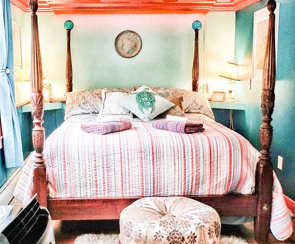 Your comfortable, sunny queen bed, with a quality mattress for a great night's sleep away from home. We only use cotton sheets and towels and unscented detergent for your comfort.