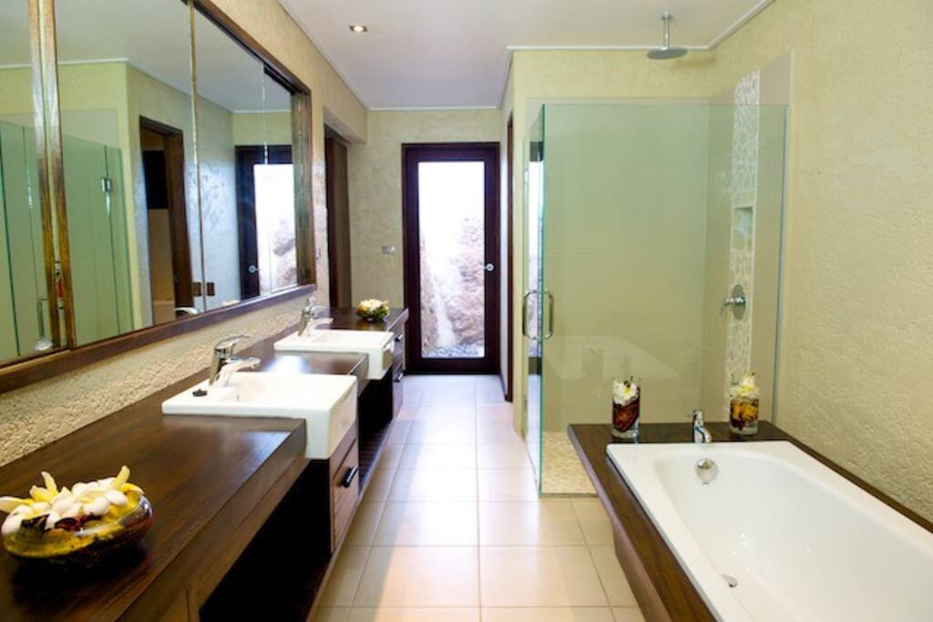 Large bathrooms with indoor and outdoor showers