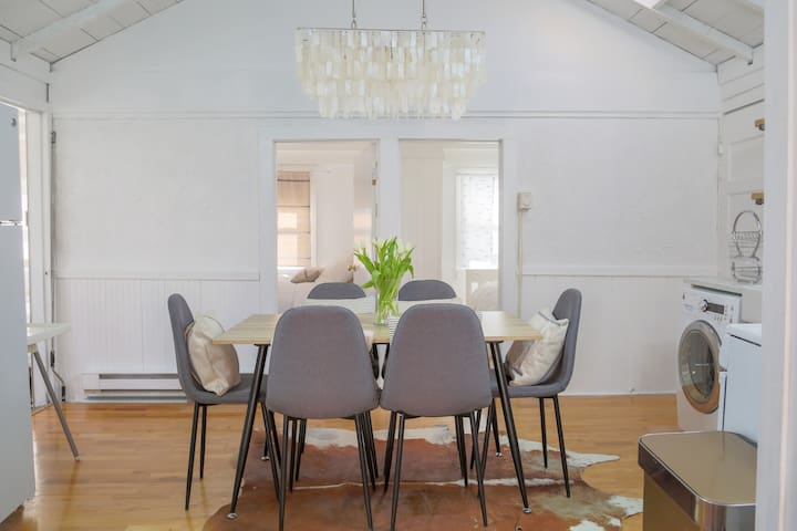 Vaulted ceiling dining and kitchen area, with capiz shell chandelier on a dimmer switch for relaxed, sophisticated dining.