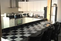 Large and spacious full Kitchen with eating bar