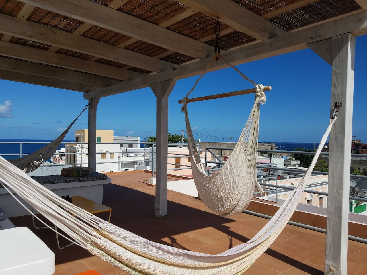 Hang out on our rooftop terrace -- also great for sleeping al fresco if you like. Two benches, two hammocks, and a hammock seat await you.