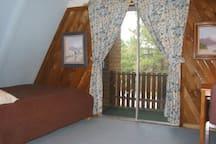 Upstairs bedroom with balcony