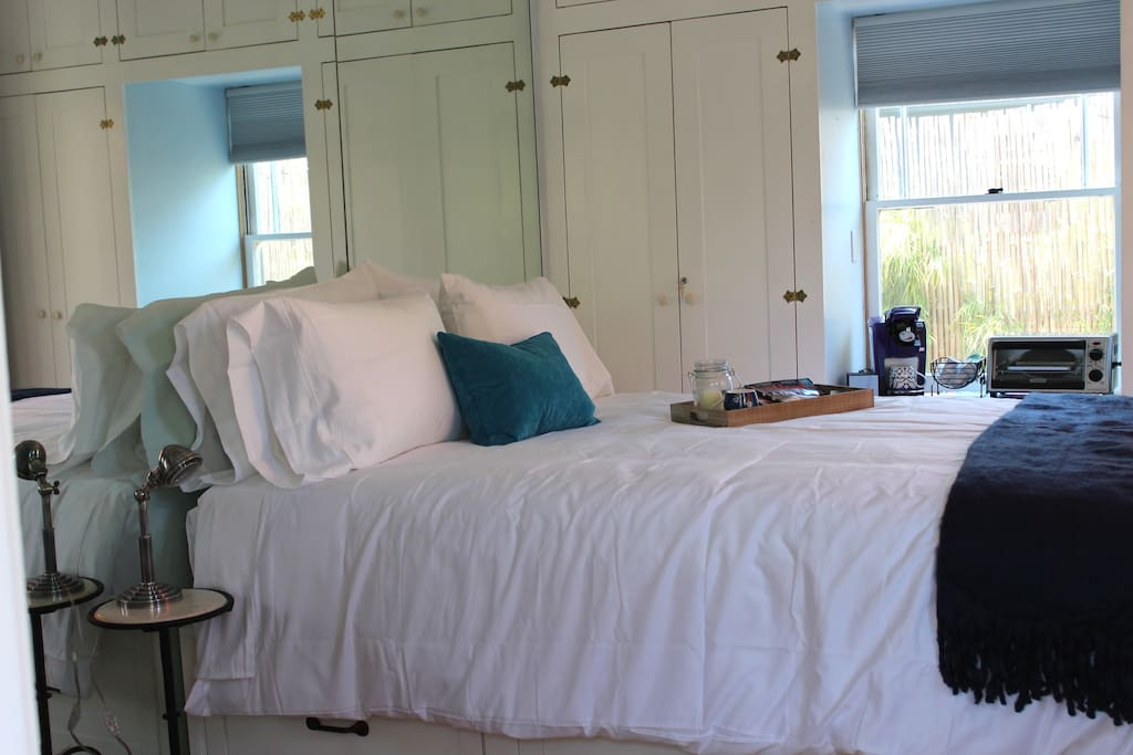 New queen-size bed with ultra soft Ralph Lauren bed sheets. Luxurious down-alternative comforter and pillows.