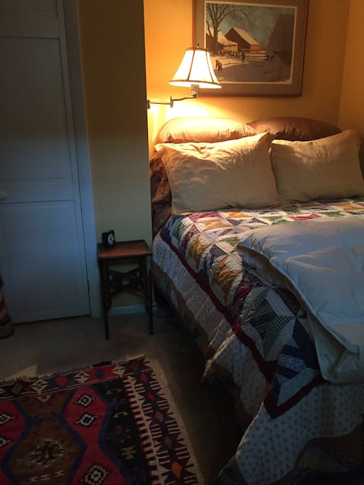 Very cozy double bed. Your host has a thing for feather pillows and great sheets.