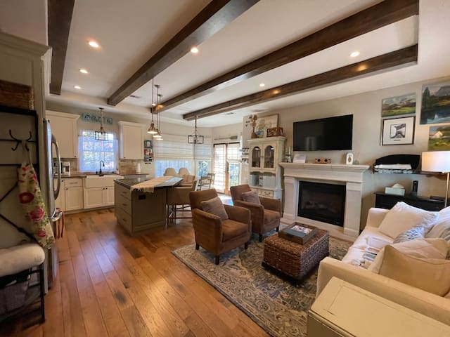 Family room with plenty of seating, gas fireplace, smart tv and a queen sleeper.