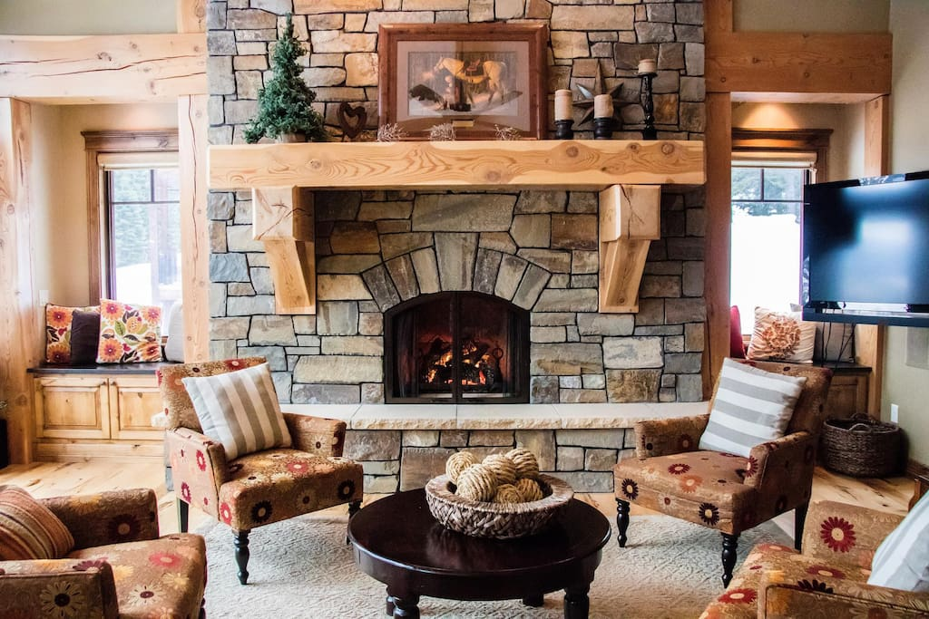 Fireplace and massive wood beam mantle