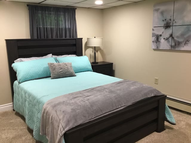Downstairs bedroom with queen bed.  The bedside table lamp has a USB port for handy phone charging while you sleep.